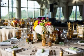 rustic-reception-amber-mercury-glasses-and-water-goblets-glass-windows