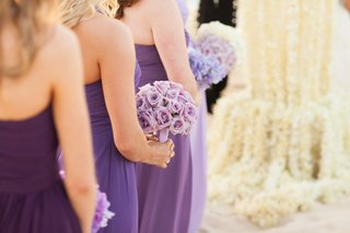 bridesmaids-in-purple-dresses-holding-lavender-roses