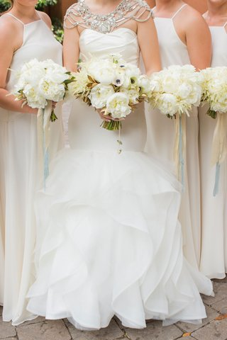 bride-in-hayley-paige-mermaid-gown-with-bridesmaids-in-white-ivory-bouquets-peony-flowers