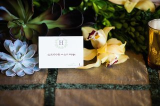 escort-card-with-logo-on-rustic-table