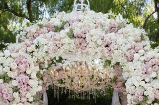 wedding-ceremony-chuppah-white-pink-rose-flowers-chandelier-crystal-beverly-hills-hotel-garden