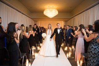 bride-in-romona-keveza-a-line-gown-plunging-neckline-with-groom-recessional