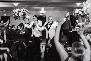 same-sex-wedding-inspiration-black-and-white-photo-of-gay-wedding-grand-entrance