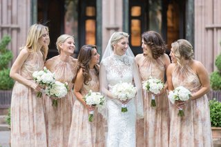 bridesmaids-in-high-neck-flower-printed-bridesmaid-dresses-hair-in-updo-worn-down