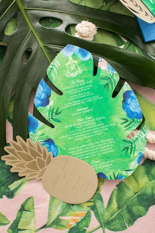 palm-tree-leaf-shape-tropical-menu-card-and-pineapple-rehearsal-dinner-invite-enclosure-gold-green
