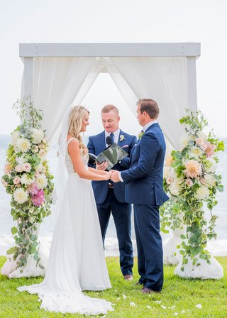 wedding-ceremony-ocean-view-green-bluff-white-structure-drapery-dahlia-rose-greenery-eucalyptus