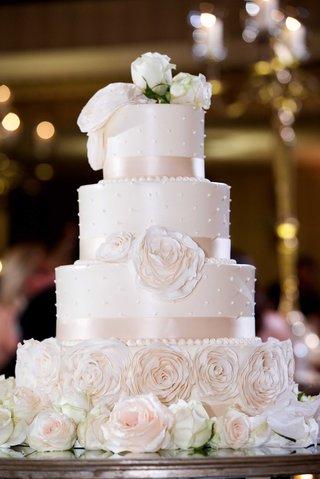 four-tier-wedding-cake-sugar-flowers-pearl-dots-ribbon-detailing-fresh-flowers