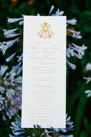 wedding-ceremony-program-gold-monogram-with-calligraphy-and-music-selections-modern-tunes