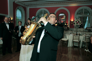 saxist-musician-entertaining-guests-at-reception