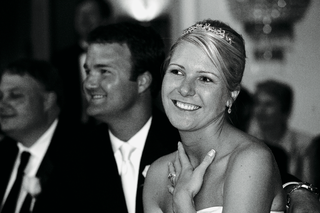 black-and-white-photo-of-newlyweds-at-table