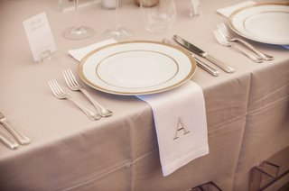 neutral-wedding-table-reception-decor-tan-linen-white-napkin-with-tan-monogram-a-initial