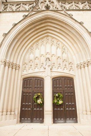 wedding-ceremony-venue-in-indiana-presbyterian-church-arch-tall-brown-wood-doors-wreaths