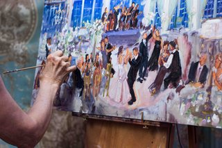 woman-painting-picture-of-bride-and-groom-at-reception