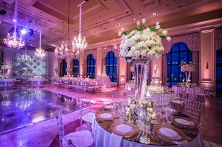 wedding-reception-in-ballroom-pink-violet-lighting-rose-tulip-hydrangea-centerpiece-in-vase