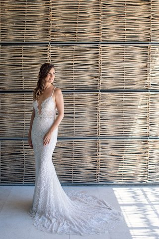 wedding-portrait-of-bride-in-berta-wedding-dress-long-hair-pulled-to-side-plunging-neckline-form-fit
