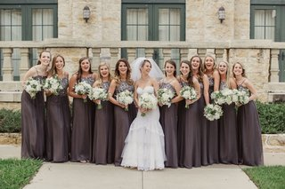 bride-and-bridesmaids-in-michael-faircloth-grey-long-dresses-with-white-bouquets-and-greenery