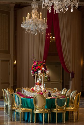 turquoise-linen-pink-florals-and-napkins-gold-chairs-multi-colored-arrangement