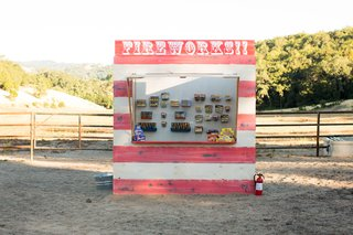 red-and-white-wooden-firework-booth-at-fourth-of-july-party