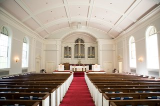 church-wedding-ceremony-with-red-center-aisle