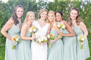 bride-in-a-lace-watters-dress-and-bridesmaids-in-different-seafoam-j-crew-dresses