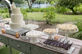 dessert-table-cake-mixed-mini-macarons-confetti-popcorn-cake-pops-pudding-shots-and-cream-puffs
