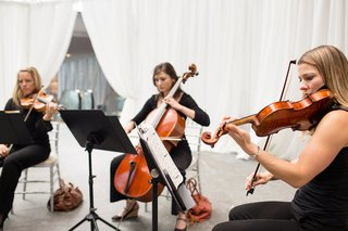 three-instrumentalists-violins-cello-white-curtains-music-stands-ceremony