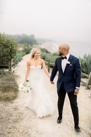 bride-in-strapless-wedding-dress-and-groom-shane-vereen-nfl-player-in-suit-navy-with-black-pants
