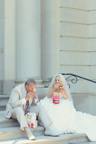 bride-in-maggie-sottero-dress-with-a-ruffled-skirt-veil-and-father-in-a-tan-suit-eat-happy-meals