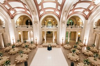 wedding-reception-round-tables-tall-greenery-centerpieces-elegant-timeless-classic-decor