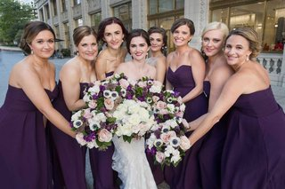 bride-with-bridesmaids-purple-bridesmaid-dresses-purple-anemone-rose-flower-bouquets
