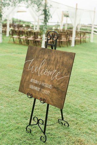 wood-welcome-sign-on-wrought-iron-easel-outdoor-wedding-ceremony-reception-montage-kapalua-bay