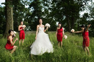bride-in-a-strapless-monique-lhuillier-gown-with-bridesmaids-in-short-red-calvin-klein-dresses