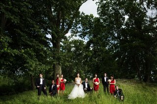bride-in-a-monique-lhuillier-gown-groom-and-groomsmen-in-a-black-tuxedos-and-bridesmaids-in-red