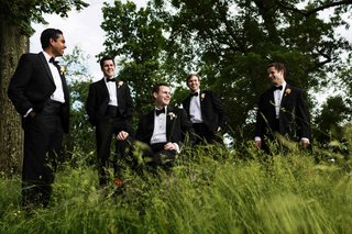 groom-and-groomsmen-in-black-tuxedos-on-the-grounds-of-sleepy-hollow-country-club