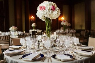 wedding-reception-centerpiece-with-white-hydrangeas-and-red-peonies