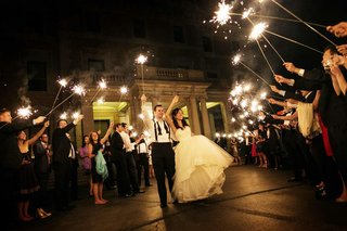 bride-in-a-monique-lhuillier-gown-and-groom-in-a-black-tuxedo-at-sparkler-send-off