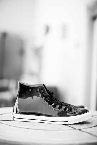 black-and-white-photo-of-leather-converse-shoes