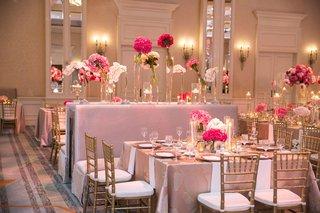 wedding-reception-ballroom-pink-centerpiece-pink-banquette-bench-gold-chiavari-chairs