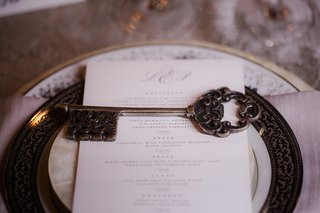 wedding-reception-place-setting-with-gold-rimmed-plate-pearl-plate-brass-antique-key-wedding-favor