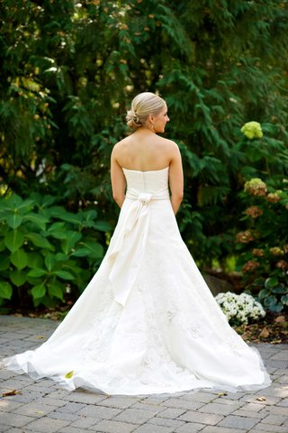 bride-in-a-strapless-vera-wang-dress-with-embroidered-lace-sash-updo-at-lake-geneva-country-club