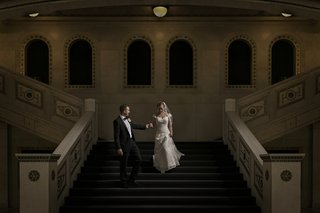 james-thoughtfully-led-jen-down-the-stairs-of-the-chicago-cultural-center-after-their-wedding