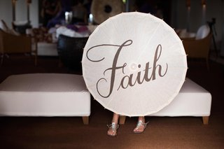 flower-girl-holding-white-parasol-with-faith-in-calligraphy