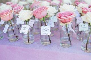 pitch-perfect-stars-anna-camp-skylar-astin-wedding-single-rose-glass-jar-escort-cards-names-guests