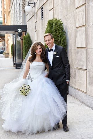 chicago-wedding-bride-in-vera-wang-strapless-dress-layer-tulle-skirt-groom-in-tuxedo-bow-tie-anemone
