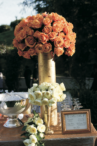 wedding-cocktail-table-decorated-with-tall-arrangement-of-roses-and-short-arrangement-of-peonies