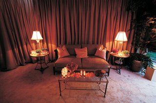 wedding-lounge-area-with-amber-draping-and-tan-sofa