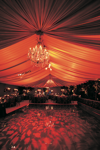 wedding-reception-with-amber-draping-chandeliers-and-black-dance-floor