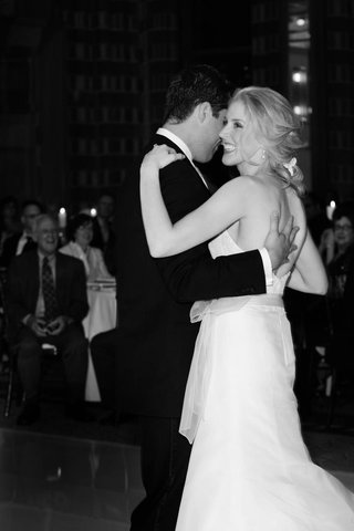 black-and-white-photo-of-bride-and-groom-ballroom-dancing