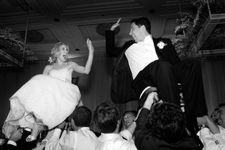 black-and-white-photo-of-bride-and-groom-hora-dance