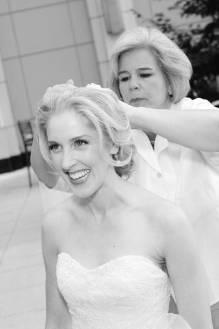 black-and-white-photo-of-bride-getting-hair-done